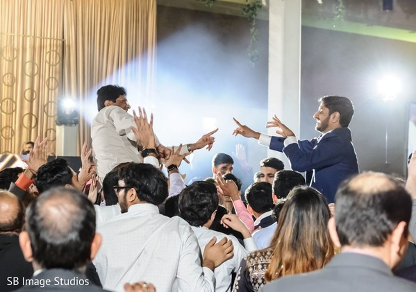 Upbeat Indian groom and guest dance performance.