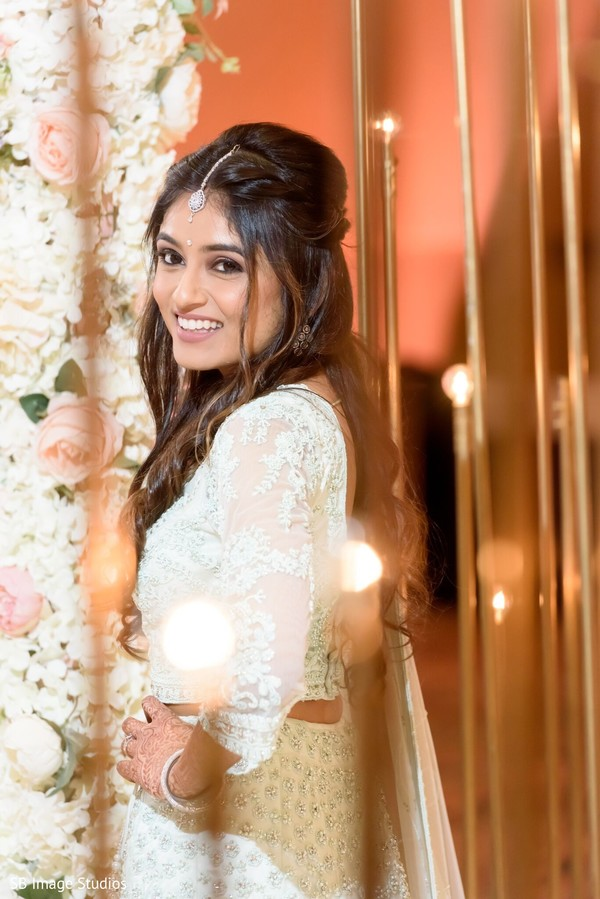Adorable Indian bride looking at camera.