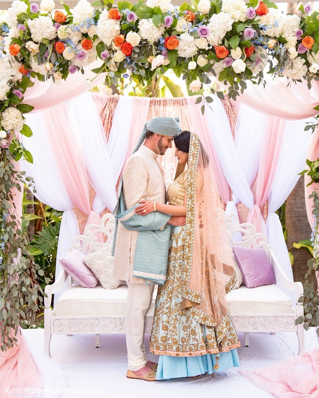 Lovely Indian bride and groom ceremony look.