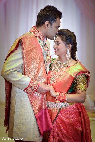 Lovely Indian groom kissing bride photo session