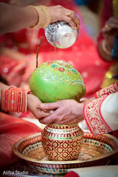 Closeup capture of Indian wedding coconut ritual.