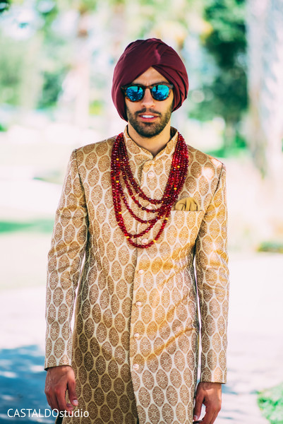 Enchanting Indian groom on his ceremony outfit.