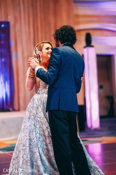 Joyful indian couple's dance photo.