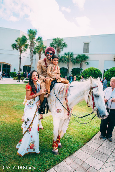 Indian groom with white baraat horse.