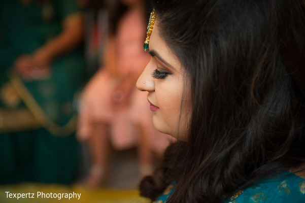 Indian bride getting ready for the ceremony