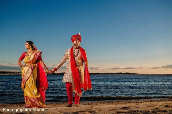 Indian bride holding hands with Raja
