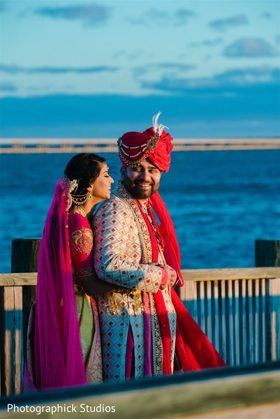 Indian groom and bride posing for pictures