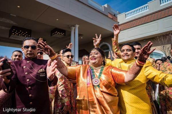 Joyful Indian wedding guests capture.