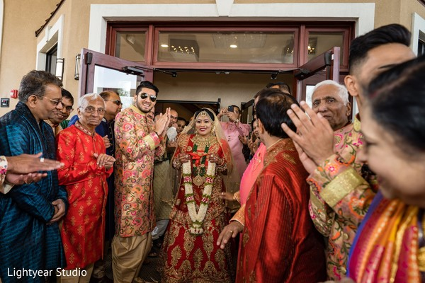Maharani with garland about to meet groom .