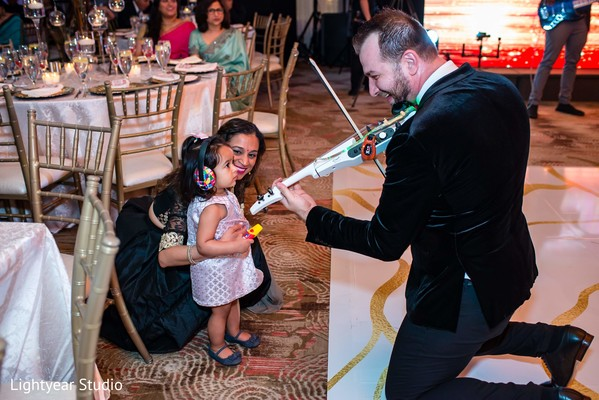 Lovely capture of Indian wedding violinist playing.