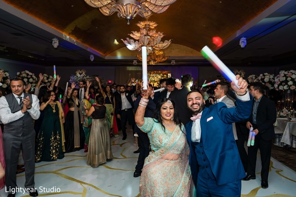 Dazzling dance of Indian bride and groom during reception