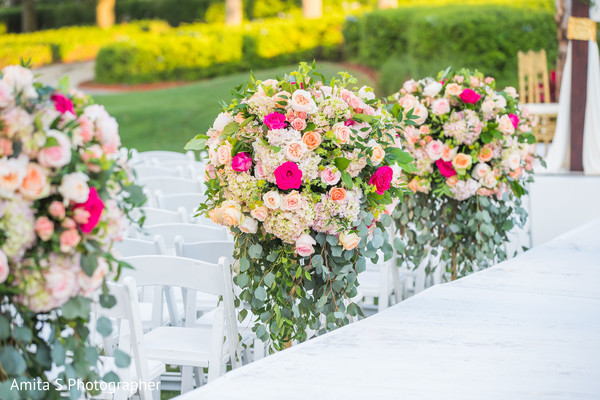 Dreamy Indian wedding ceremony aisle flowers.