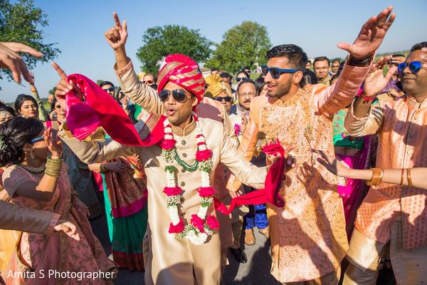 Traditional indian groom's baraat.