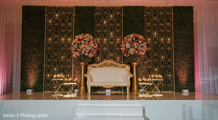 Elegant Indian wedding reception stage decor.