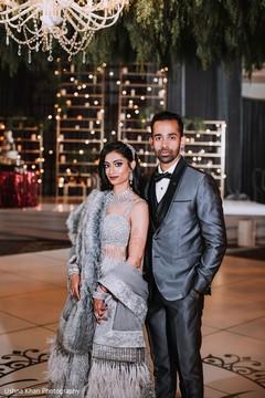 Elegant Indian couple at reception photo.