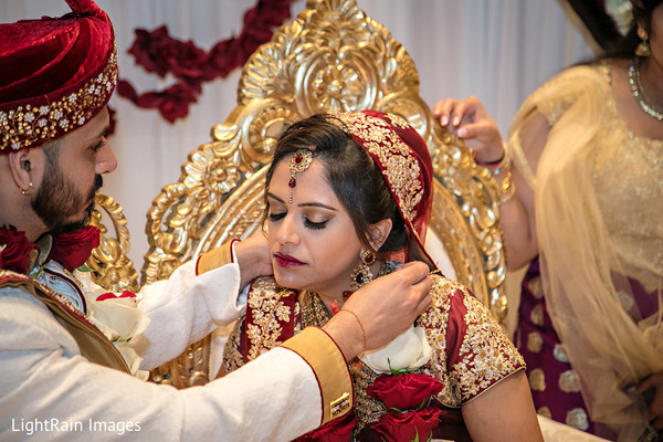 Indian groom offers bride protection with the sacred necklace.