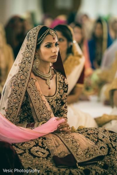 Enchanting Indian bride at her wedding ceremony.