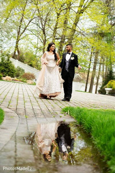 Indian groom and bride outside