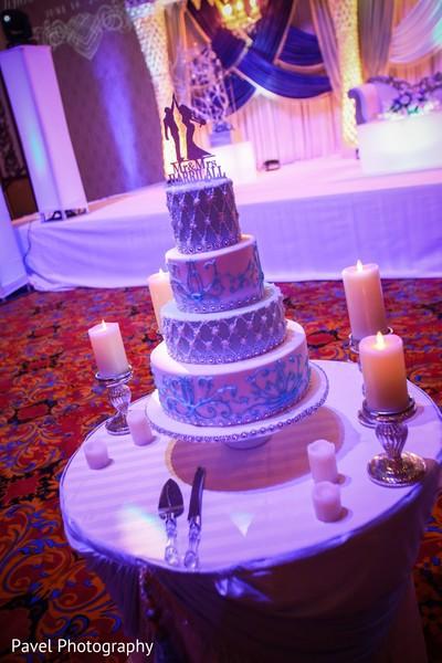 Elegant Indian wedding cake decor.