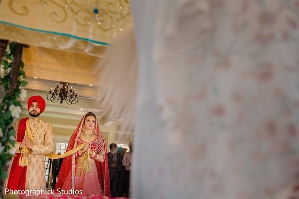 Enchanting indian lovebirds during ceremony