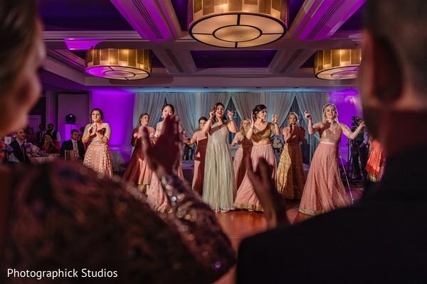 Joyful bridesmaids dancing photography
