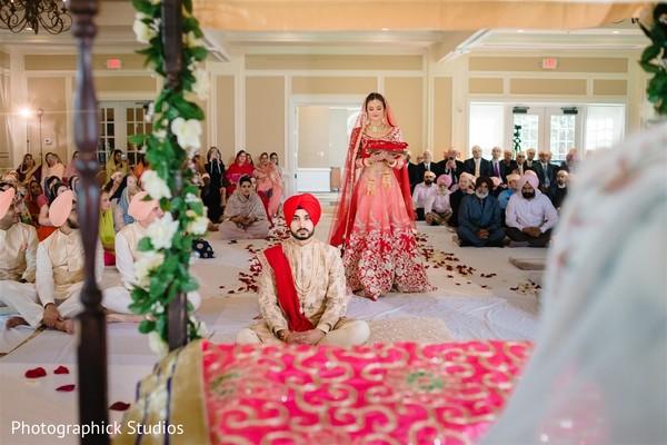 Ravishing indian bride making her entrance to wedding ceremony