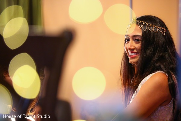 Enchanting indian bride at her mehndi party.