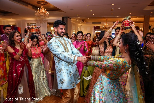 Joyful Indian bride and groom at their sangeet celebration.