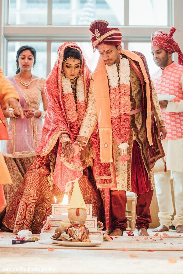 Indian bride and groom during the sacred fire rituals