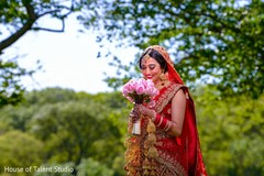 Sweet indian bride posing for photo shoot.