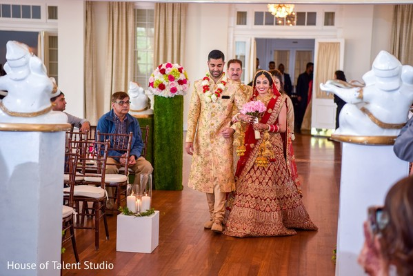 Indian brides entrance to wedding ceremony.
