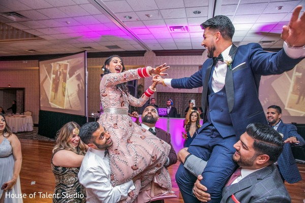 Traditional indian newlyweds reception performance.