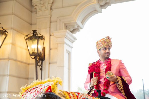 Charming Indian groom at his baraat celebration capture.