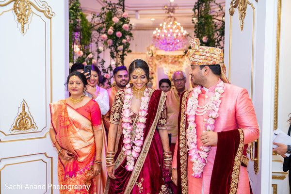 Enchanting indian lovebirds walking out from ceremony.