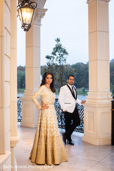 Elegant Indian couple posing for photo shoot.