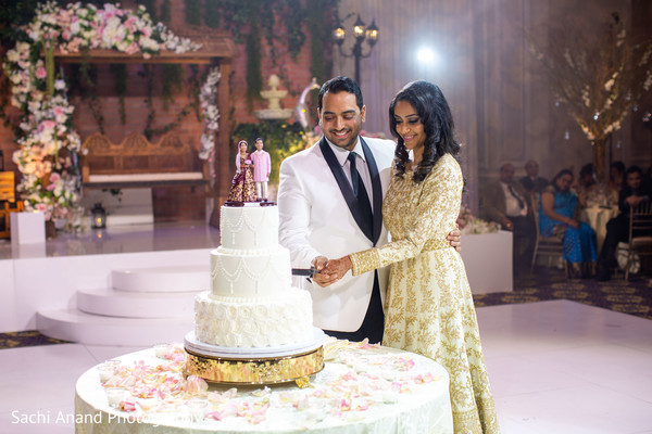 Lovely Indian couple cutting cake.