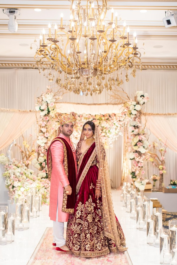 Magnificent Indian couple at wedding venue.