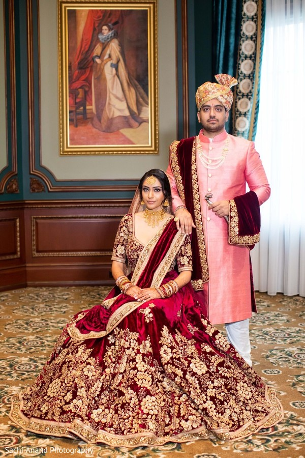 Indian lovebirds on their ceremony outfits.
