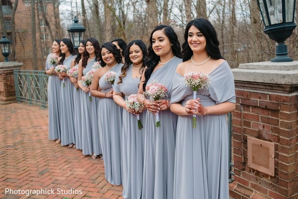 Lovely Indian bridesmaids posing with their bouquets.