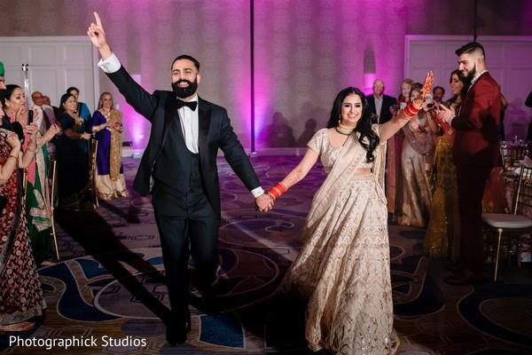 Joyful Indian bride and Indian groom at reception.