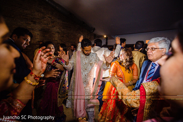 Indian groom celebrating with a dance.