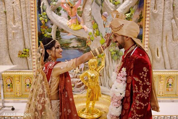Maharani putting the red mark on groom's forehead.