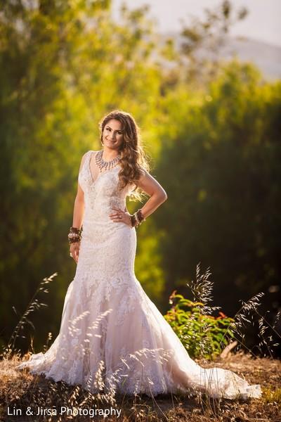 Enchanting Indian bride on her white wedding dress.