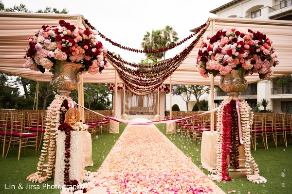 Stunning Indian wedding ceremony aisle flowers decor.