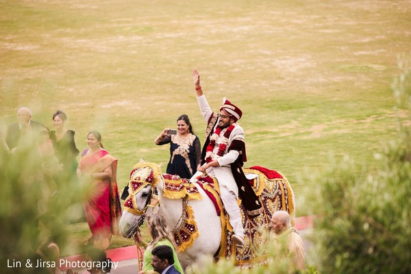 Indian groom with white baraat horse