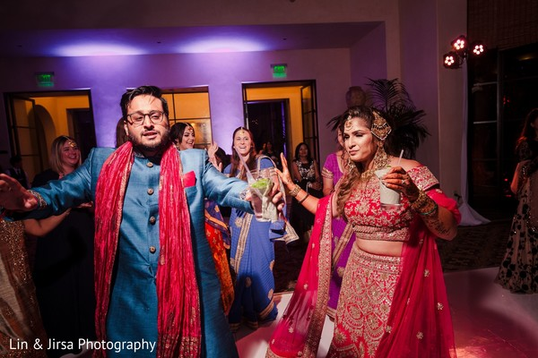 Joyful Indian couple at sangeet dance.