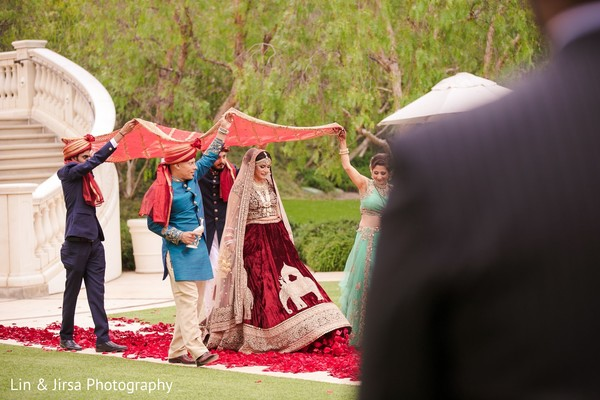 Take a look at this indian bride walking down the aisle.