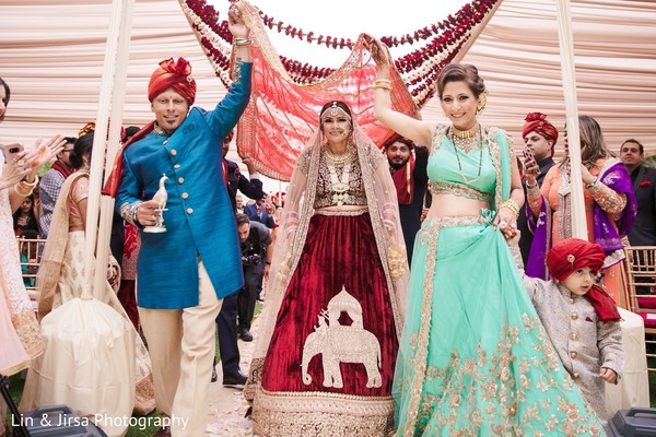 Magnificent entrance of Indian bride to wedding ceremony.