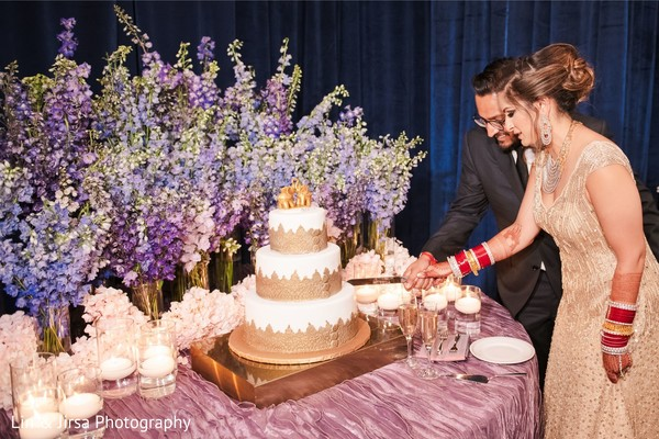 Enchanting Indian couple cutting cake moment.