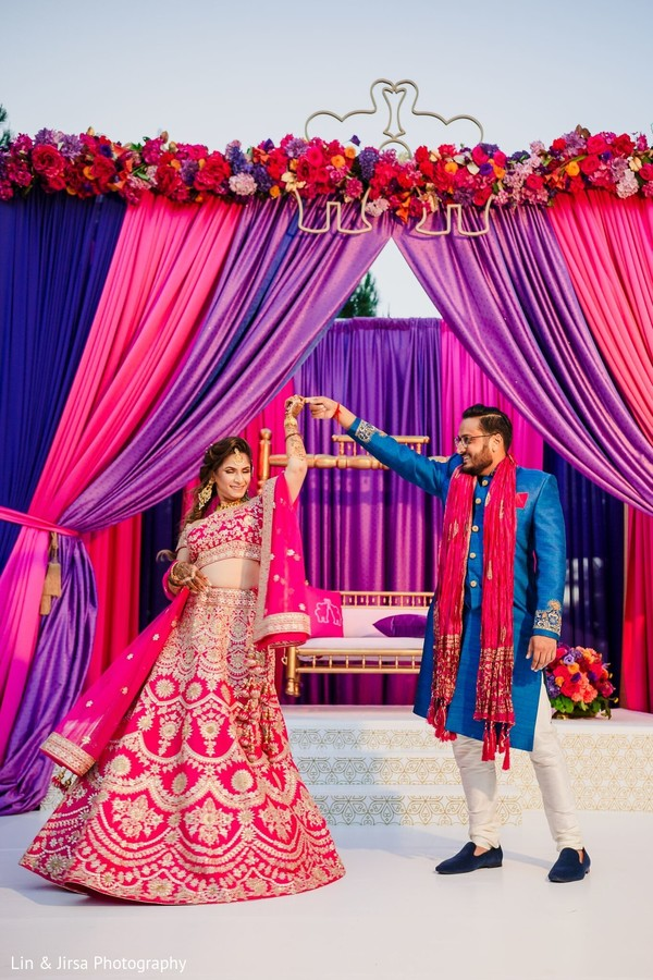 Dreamy Indian couple  on their Sangeet outfits.